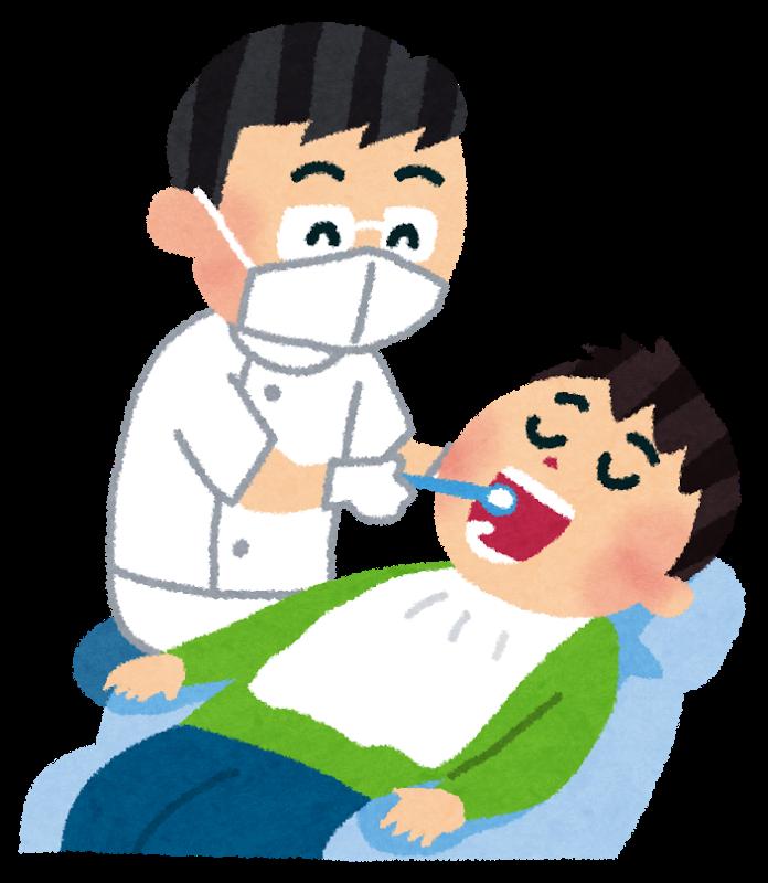 歯医者さんで虫歯を治療する様子
